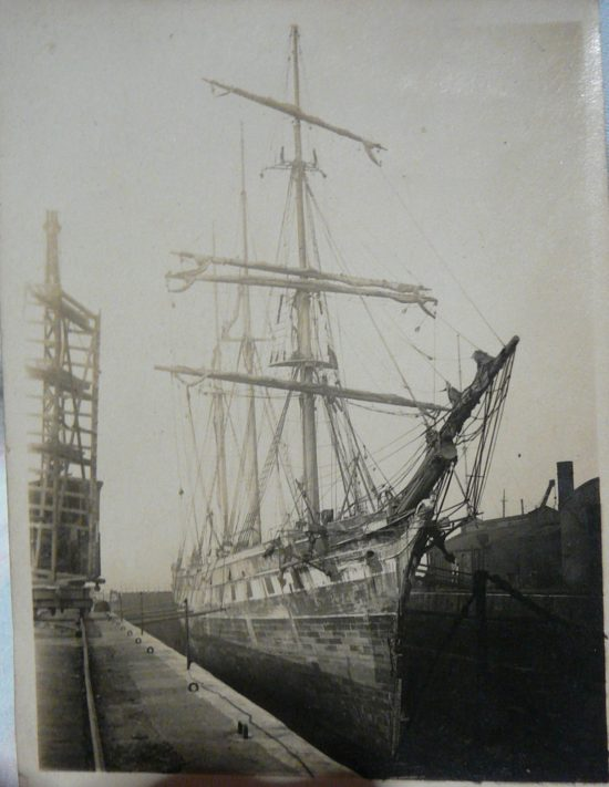 Looking aft along the starboard bow. Note the reduced barquentine rig. Compare with known image below