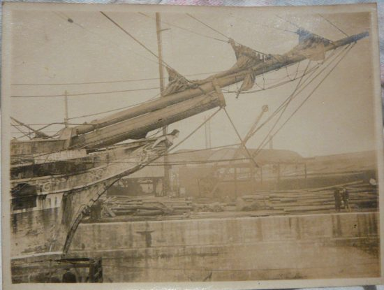Starboard bow. 'Ferreira' clearly evident, plus missing figurehead arm consistent with known damage, 1918/19